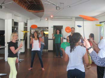 Indoor team building event circus skills workshop with Team Bonding Sydney