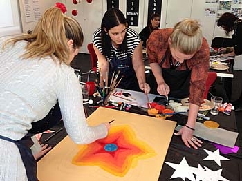 Indoor team building event of creative artwork classes with Team Bonding Sydney
