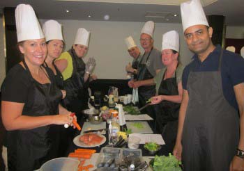 Indoor team building event group cooking class with Team Bonding Sydney